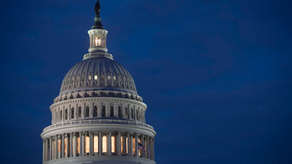 The US Capitol Building is seen at dusk in Washington, DC, February 6, 2018, as lawmakers work to avert a government shutdown later this week. (AFP)