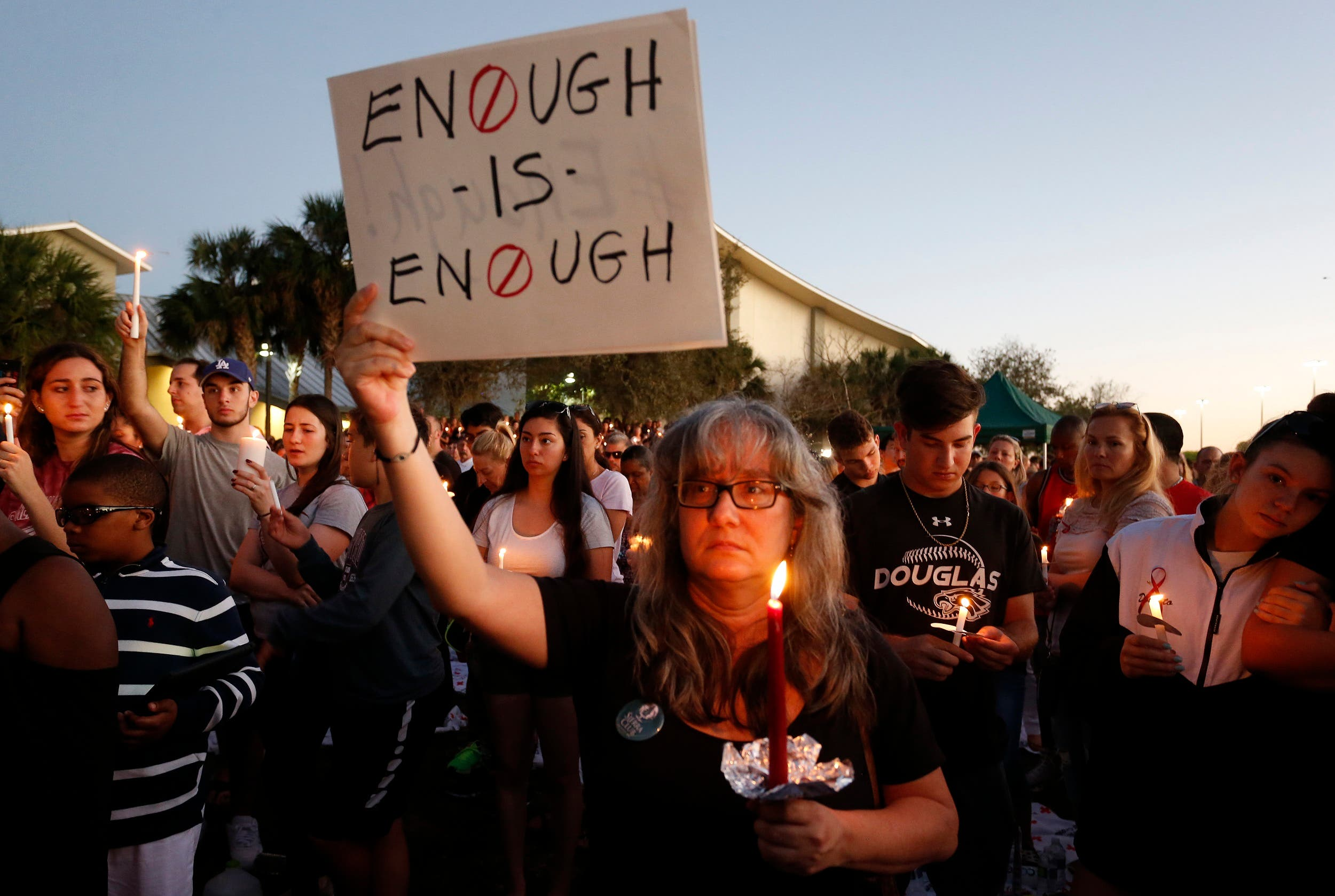 Mourners stand during a candlelight vigil for the victims of Marjory Stoneman Douglas High School shooting in Parkland, Florida on February 15, 2018. (AFP)