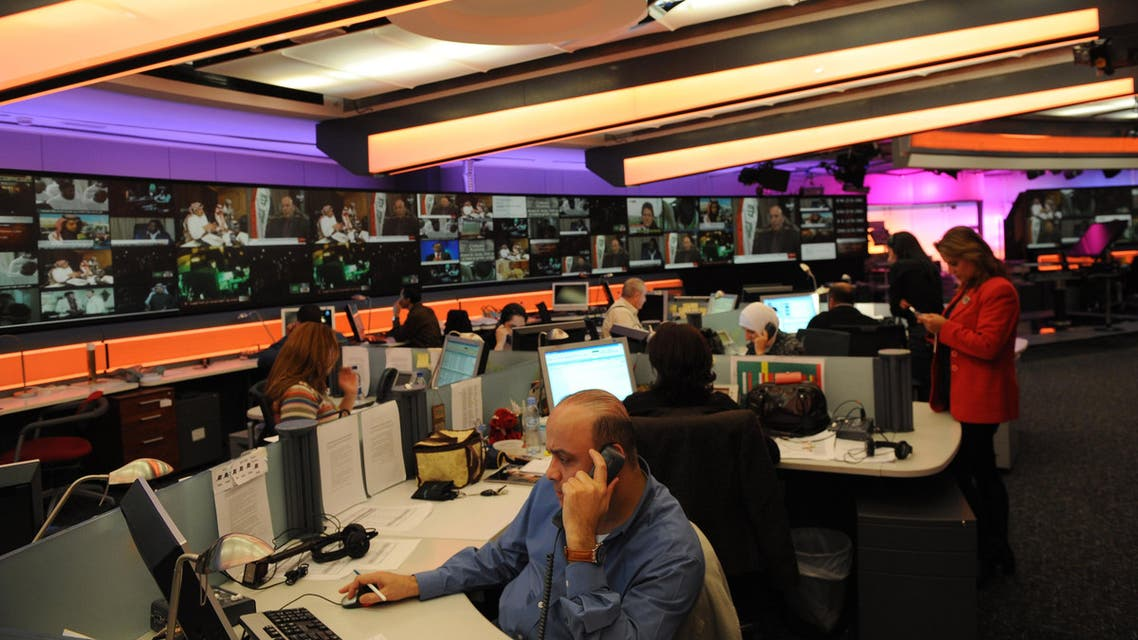 Journalists work at Al Arabiya headquarters at Dubai Media City on December, 15 2009. (AFP)