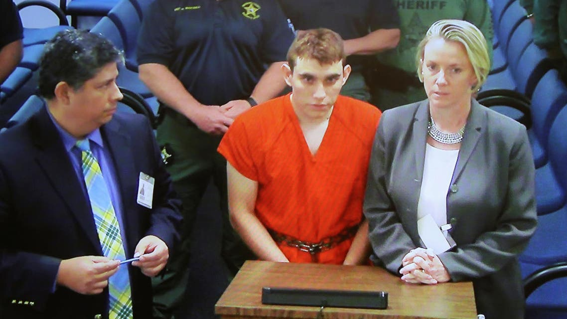 Nikolas Cruz (C) appears via video monitor at a bond court hearing after being charged with 17 counts of premeditated murder, in Fort Lauderdale, Florida, on February 15, 2018. (Reuters)