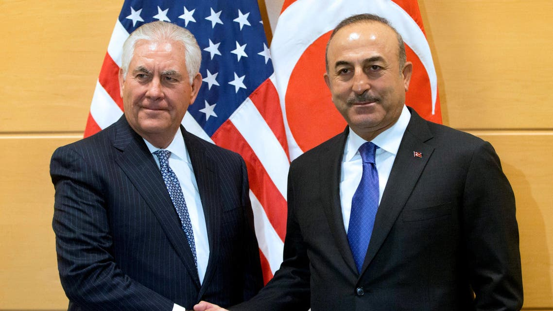 U.S. Secretary of State Rex Tillerson poses with Turkish Foreign Minister Mevlut Cavusoglu during a NATO foreign ministers meeting at the Alliance headquarters in Brussels, Belgium, December 6, 2017. REUTERS/Virginia Mayo/Pool