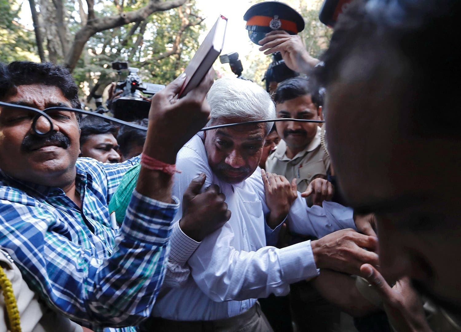 Police escort a man suspected of steering fraudulent loans to companies linked to billionaire jeweler Nirav Modi, at a court in Mumbai, India, on February 17, 2018. (Reuters)