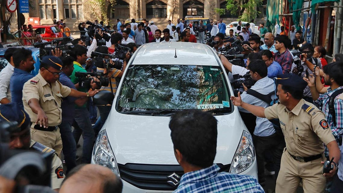 Police make way for a vehicle carrying three people suspected of steering fraudulent loans to companies linked to billionaire jeweler Nirav Modi, at a court in Mumbai, India, February 17, 2018. (Reuters)