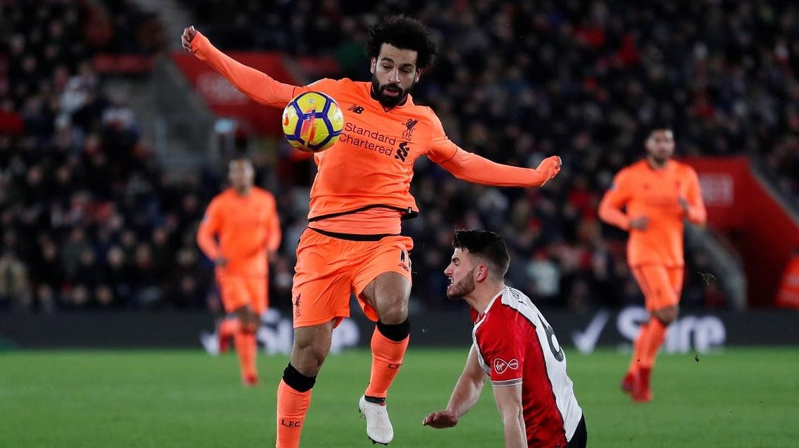 Liverpool's Mohamed Salah in action with Southampton's Wesley Hoedt. (Reuters)