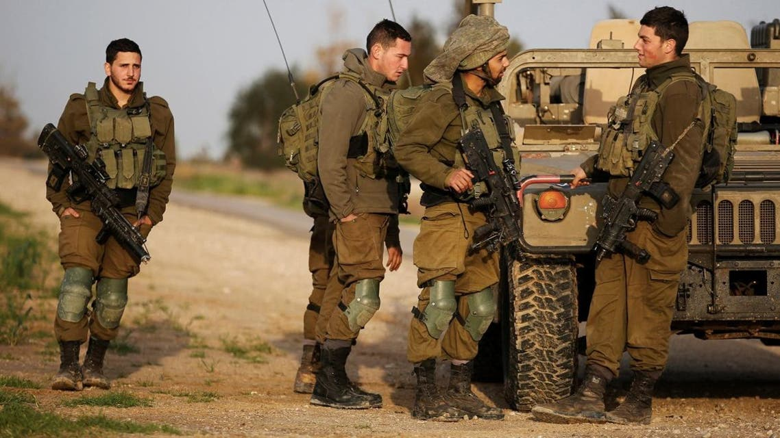 Israeli soldiers stands near a military jeep next to the border fence with the southern Gaza Strip near Kibbutz Nirim. (File photo: Reuters)