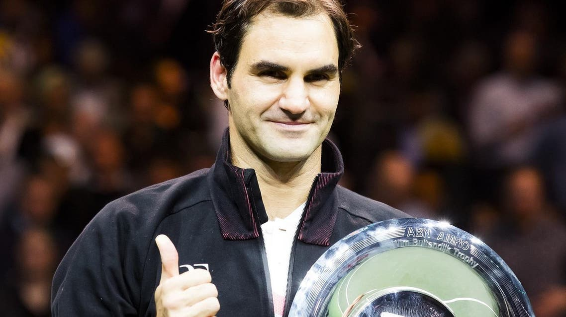 Switzerland's Roger Federer holds his trophy after winning the final match against Bulgary's Grigor Dimitrov at the ABN AMRO World Tennis Tournament in Rotterdam, on February 18, 2018. (AFP)