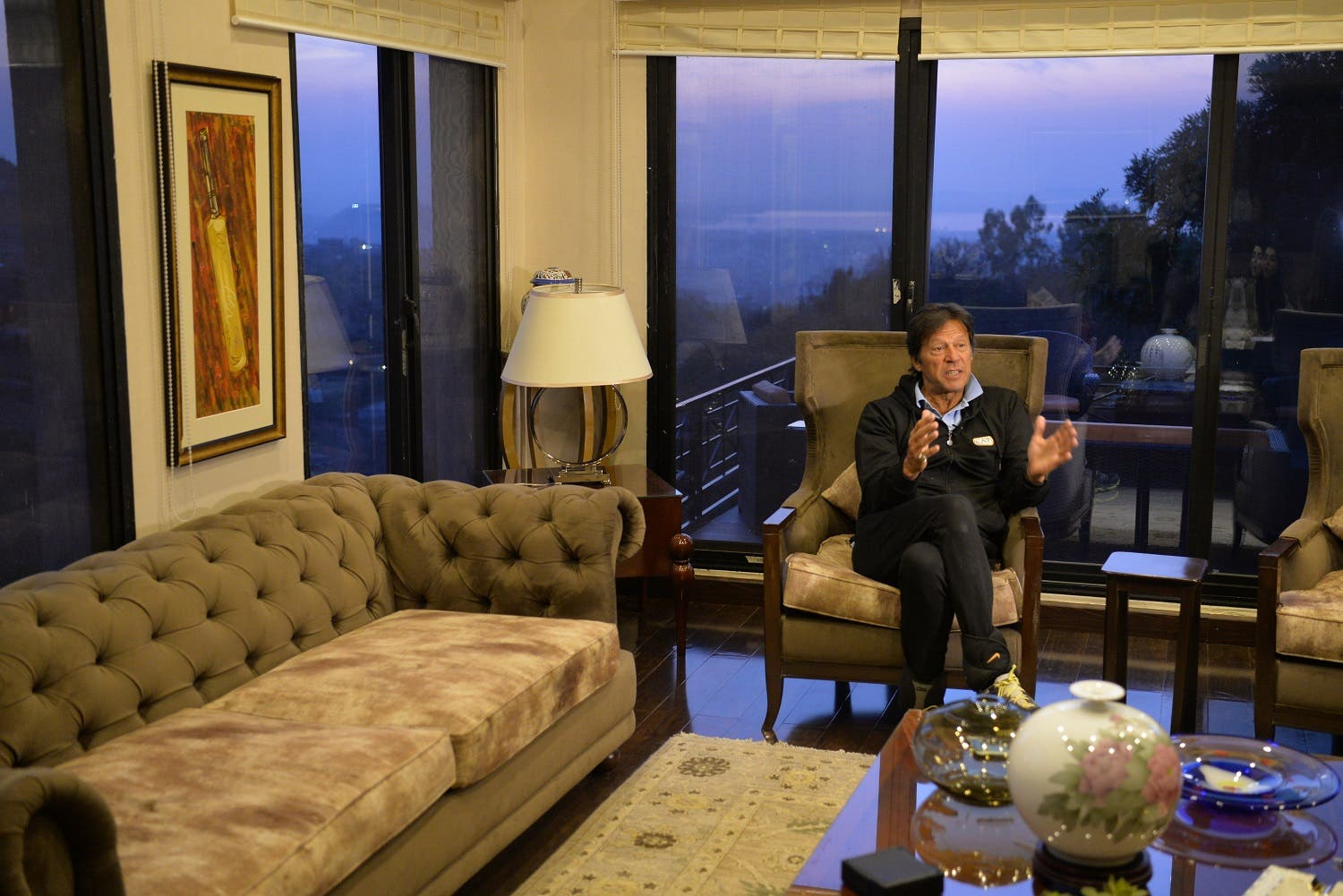 In this photograph taken on February 5, 2018, Pakistani cricketer-turned-opposition leader and head of the Pakistan Tehreek-i-Insaf (PTI), Imran Khan, speaks during an interview with AFP at his home in Islamabad. (AFP)