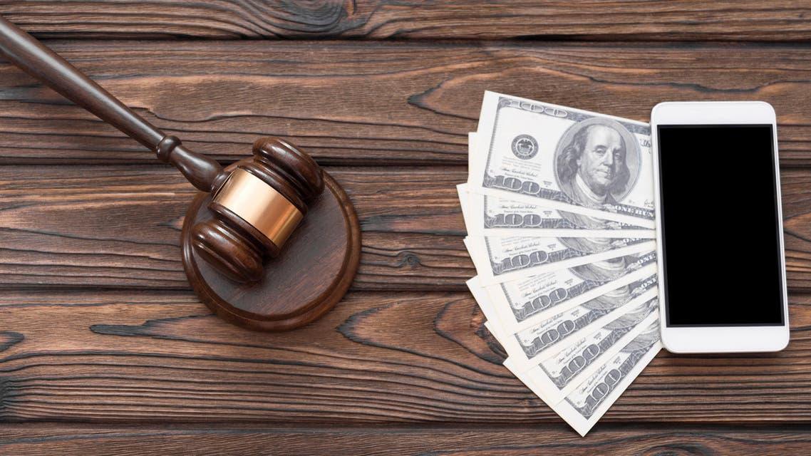 Court phone money. (Shutterstock)
