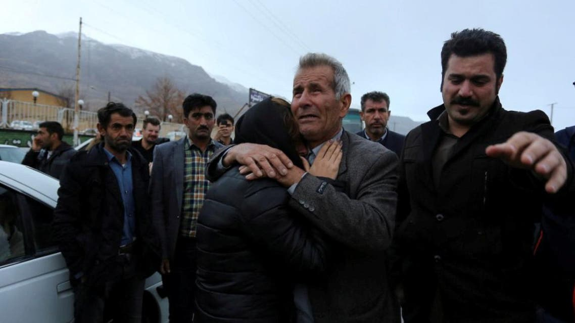 Relatives of a passenger who was believed to have been killed in a plane crash react near the town of Semirom, Iran, February 18, 2018. REUTERS