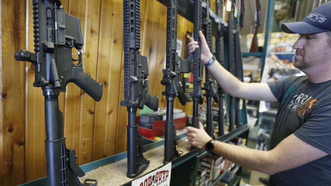OREM, UT - FEBRUARY 15: Dordon Brack, pulls a semi-automatic AR-15 off the rack, that is for sale at Good Guys Guns & Range on February 15, 2018 in Orem, Utah. An AR-15 was used in the Marjory Stoneman Douglas High School shooting in Parkland, Florida. George Frey/Getty Images/AFP  GEORGE FREY / GETTY IMAGES NORTH AMERICA / AFP