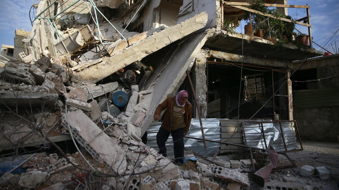 A person inspects damaged building in the besieged town of Douma, Eastern Ghouta, Damascus, Syria February 20, 2018. REUTERS/Bassam Khabieh
