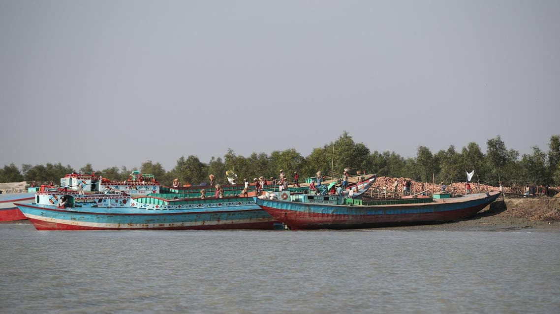 Ferries carry construction materials on the island of Bhasan Char, in the Bay of Bengal, Bangladesh on February 14, 2018. (Reuters)