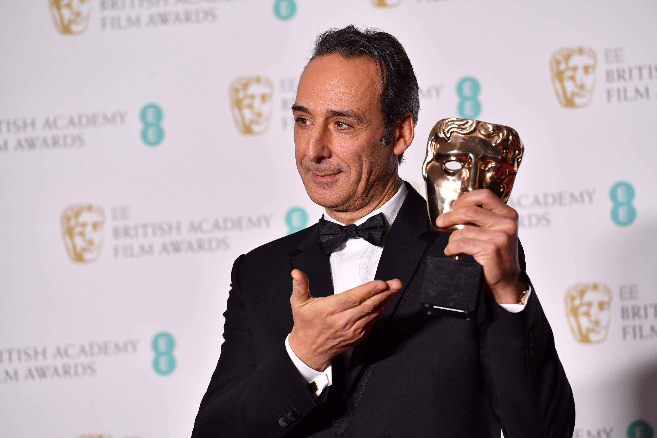 French composer Alexandre Desplat poses with the award for Original Music for The Shape Of Water at BAFTA in London on February 18, 2018. (AFP)
