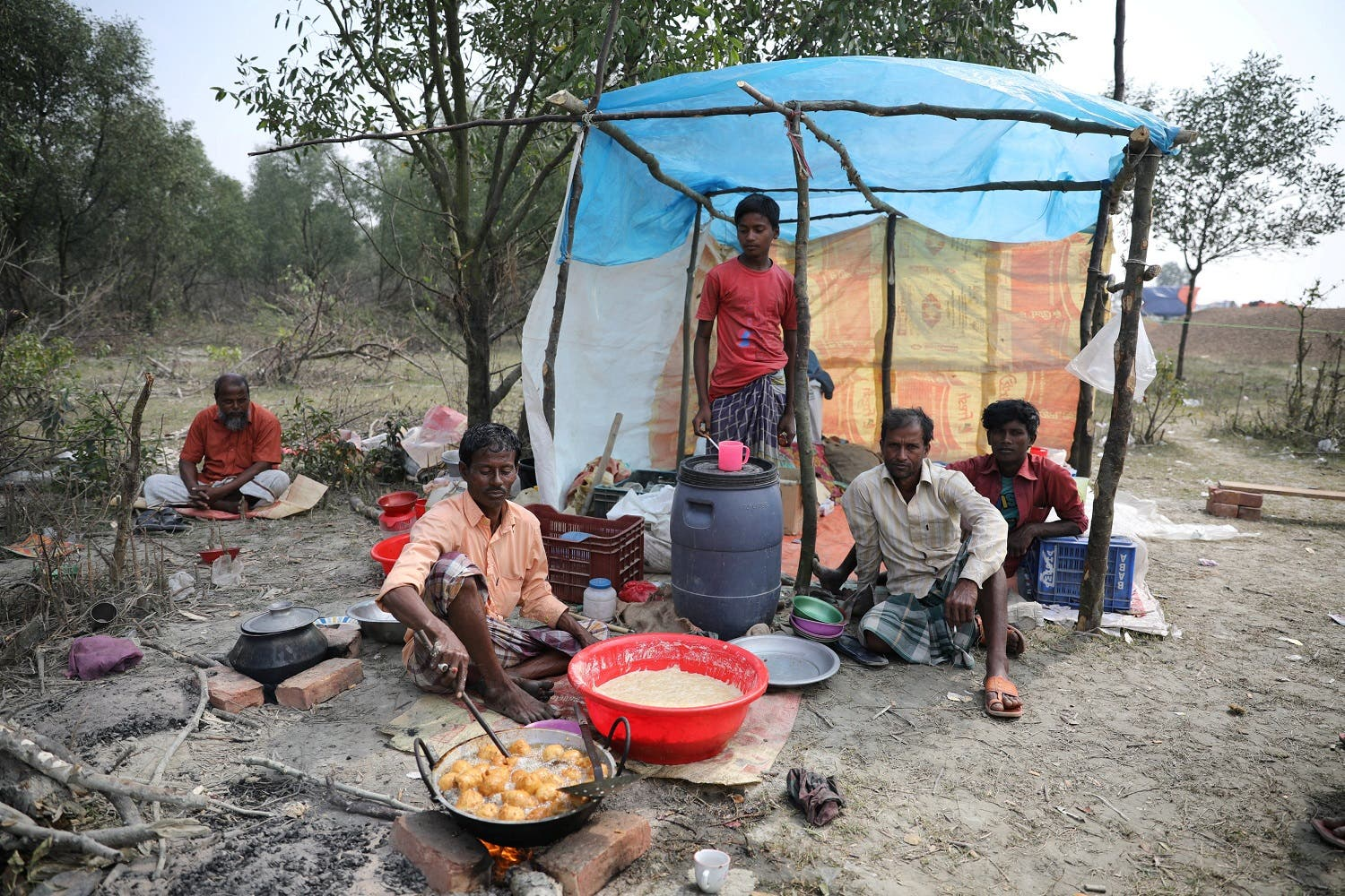 A man cooks a meal in his makeshift restaurant on the island of Bhasan Char in the Bay of Bengal on February 14, 2018. (Reuters)