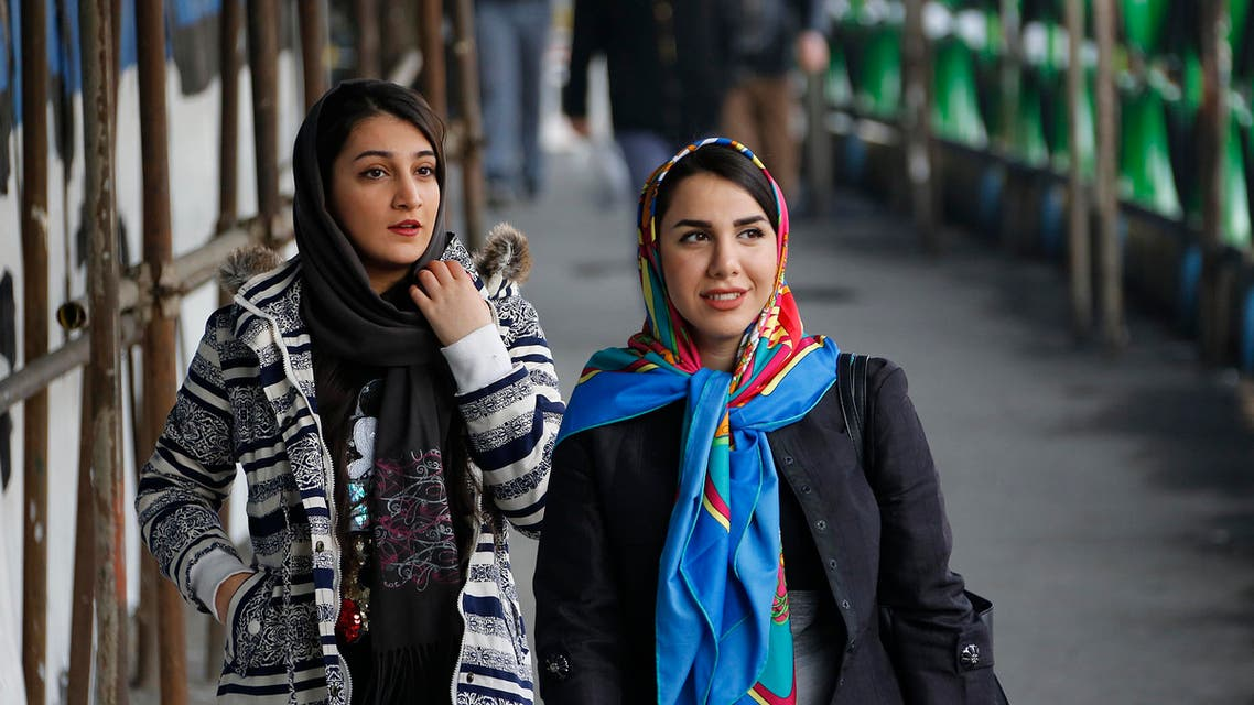 Iranian women wearing hijab walk down a street in the capital Tehran on February 7, 2018. A spate of unprecedented protests against Iran's mandatory headscarves for women have been tiny in number, but have still reignited a debate that has preoccupied the Islamic republic since its founding.