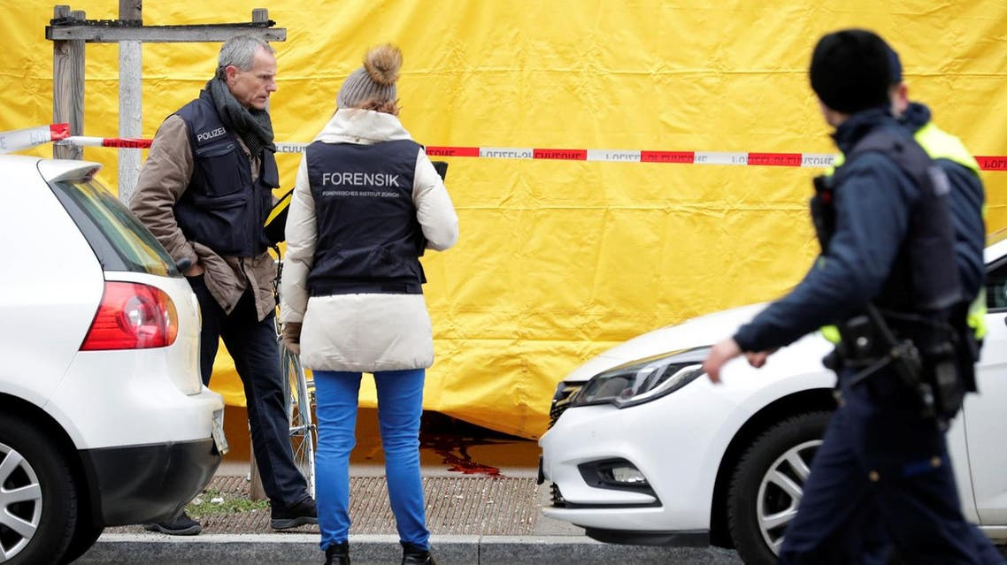 Police investigate a crime scene after two people, police said, were killed in Zurich, Switzerland, February 23, 2018. REUTERS