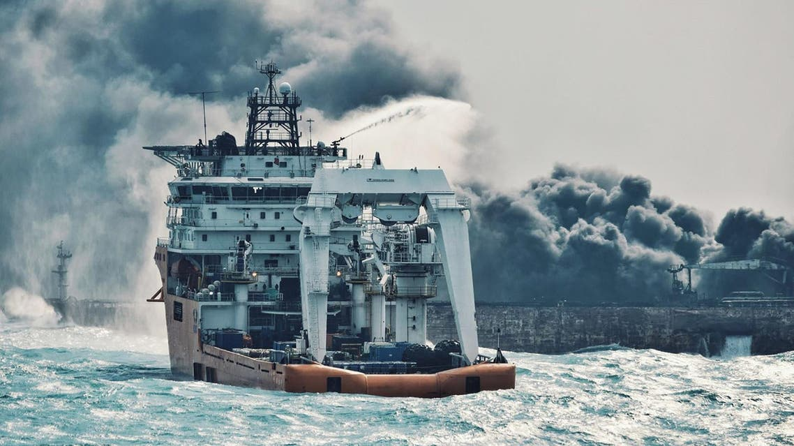 Chinese offshore supply ship spraying foam on Sanchi at sea off the coast of eastern China on January 10. (AFP)