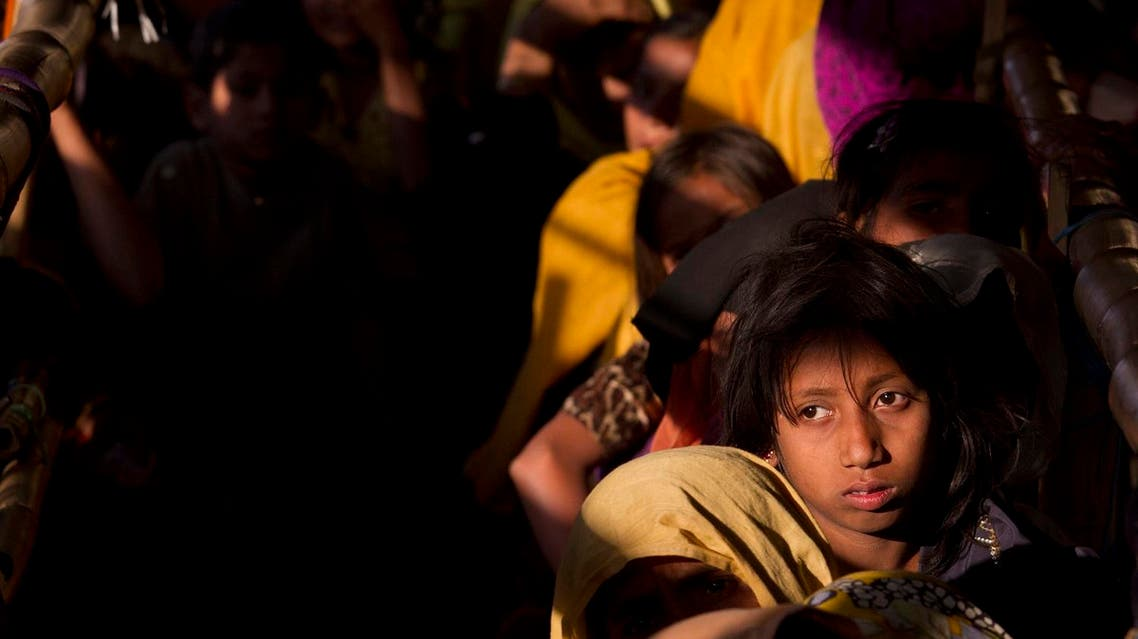 In this file photo, Rohingya Muslim women refugees wait in a queue to receive relief material at the Balukhali refugee camp near Cox's Bazar, Bangladesh. (AP)