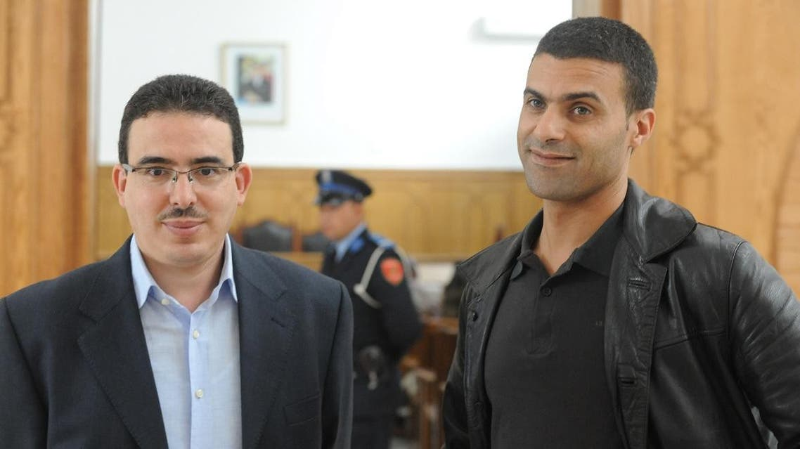 Taoufik Bouachrine, director of the Moroccan Akhbar Al Youm newspaper and caricaturist Khalid Gueddar arrive at the court in Casablanca on October 23, 2009. (File photo: AFP)