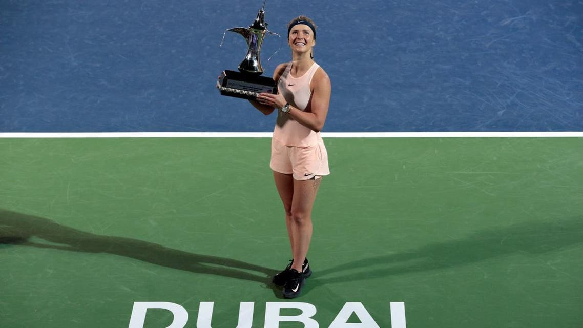 Elina Svitolina of Ukraine holds up the trophy after defeating Daria Kasatkina of Russia. (Reuters)