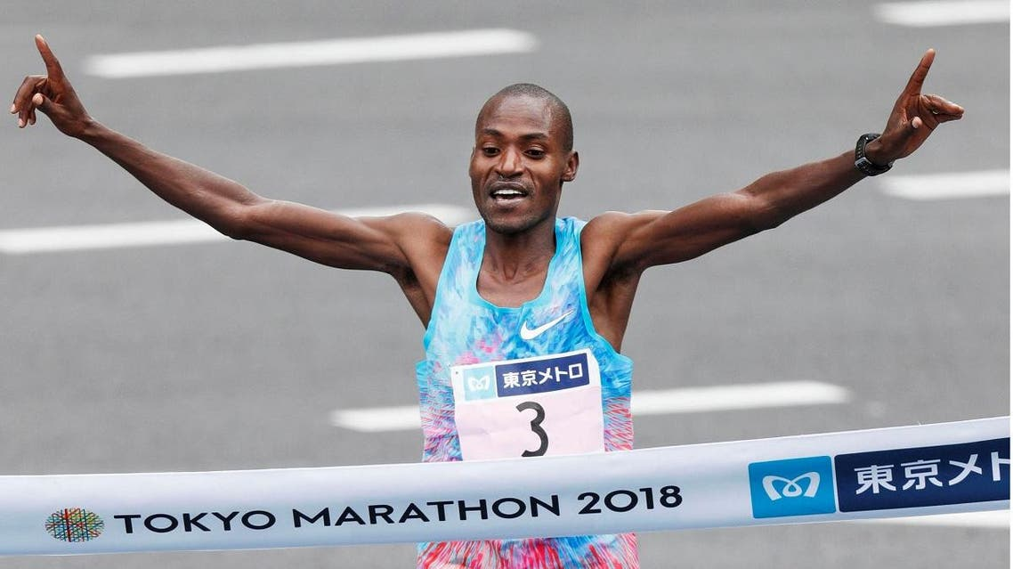 Dickson Chumba of Kenya crosses the finish line to win the Tokyo Marathon 2018 in Tokyo. (Reuters)