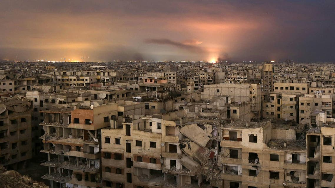 Smoke billows following a regime air strike on the besieged Eastern Ghouta region on the outskirts of the capital Damascus, late on February 23, 2018. (AFP)