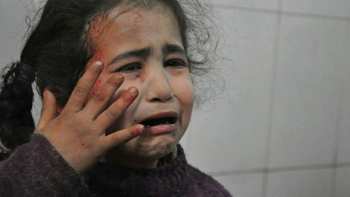 A Syrian young girl who was wounded during airstrikes and shelling by Syrian government forces, cries at a makeshift hospital, in Ghouta. (AP)