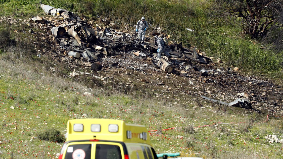 """A picture taken in the northern Israeli Kibbutz of Harduf on February 10, 2018, shows the remains of an Israel F-16 that crashed after coming under fire by Syrian air defences during attacks against """"Iranian targets"""" in the war-torn country.  Jack GUEZ / AFP"""