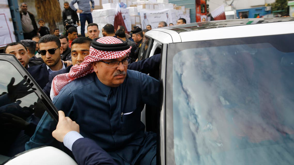 Qatari Ambassador to Gaza Mohammed al-Emadi (C) leaves following a press conference at the Dar al-Shifa hospital in Gaza City with the Director of UNRWA Operations in Gaza after Qatar signed an agreement to provide a nine million dollar humanitarian relief grant to residents of the Palestinian enclave on February 19, 2018.  Mohammed ABED / AFP