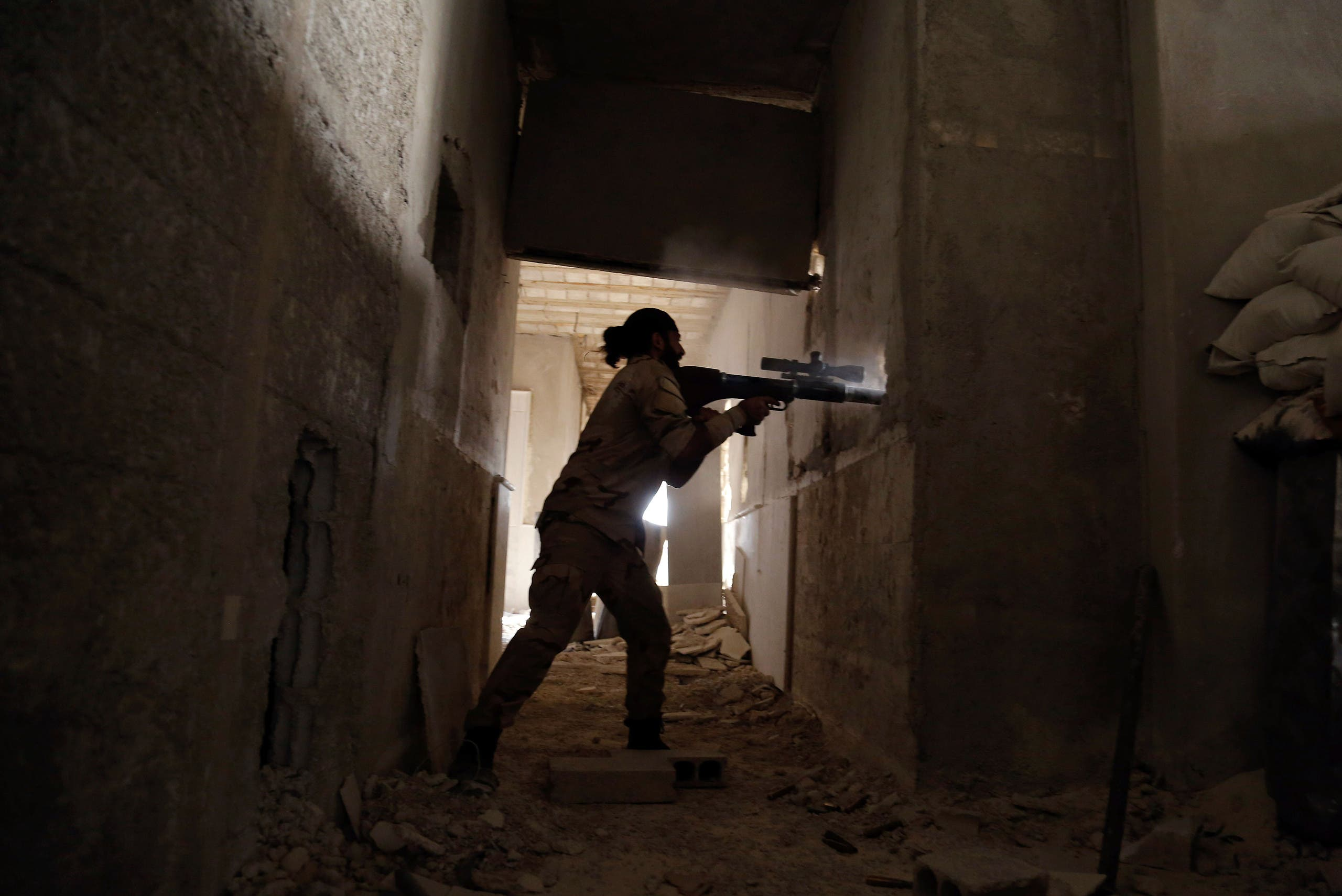 A Syrian rebel fighter fires a weapon in the eastern Ghouta area on July 17, 2017. (AFP)