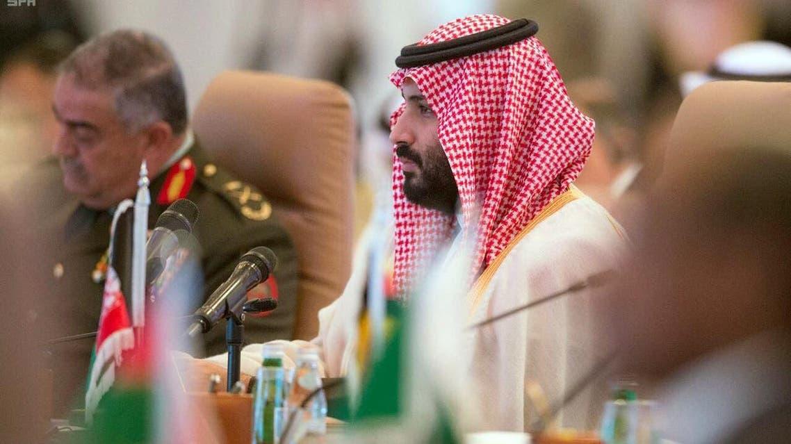 In this photo released by the state-run Saudi Press Agency, Saudi Crown Prince Mohammed bin Salman speaks at a meeting of the Islamic Military Counterterrorism Alliance in Riyadh, Saudi Arabia, Sunday, Nov. 26, 2017. (SPA)