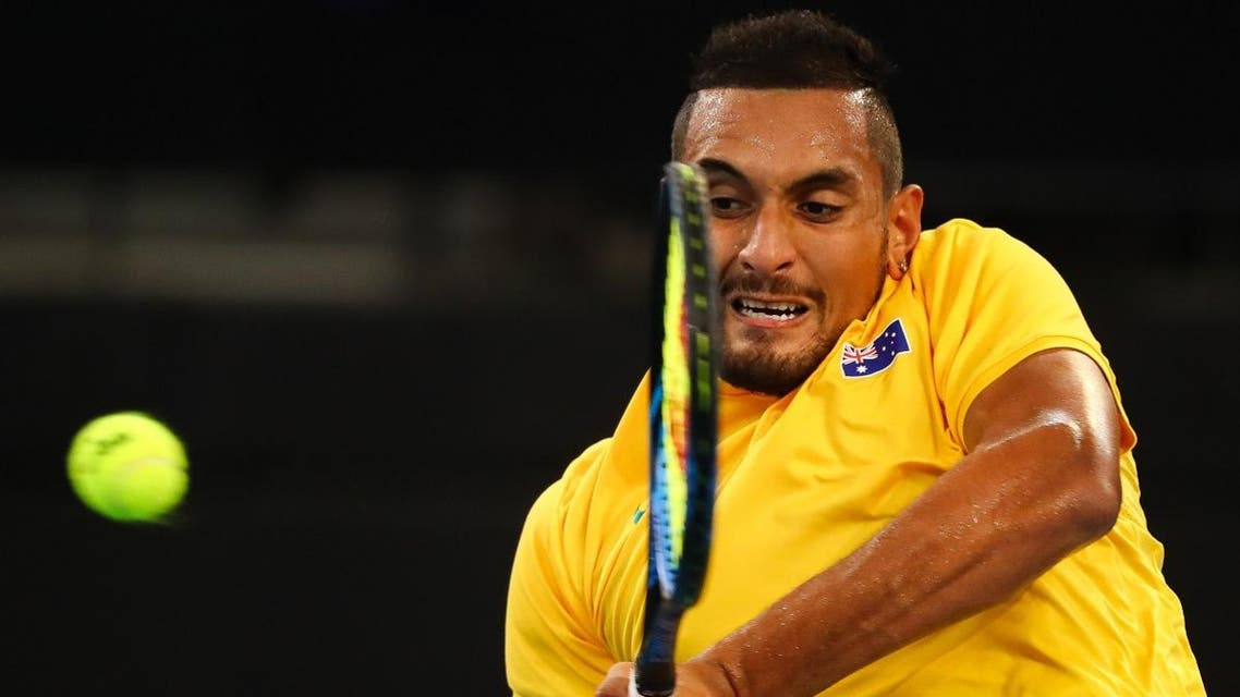 Nick Kyrgios of Australia hits a return to Jan-Lennard Struff of Germany during their men's singles second round tennis match of the Davis Cup. (AFP)