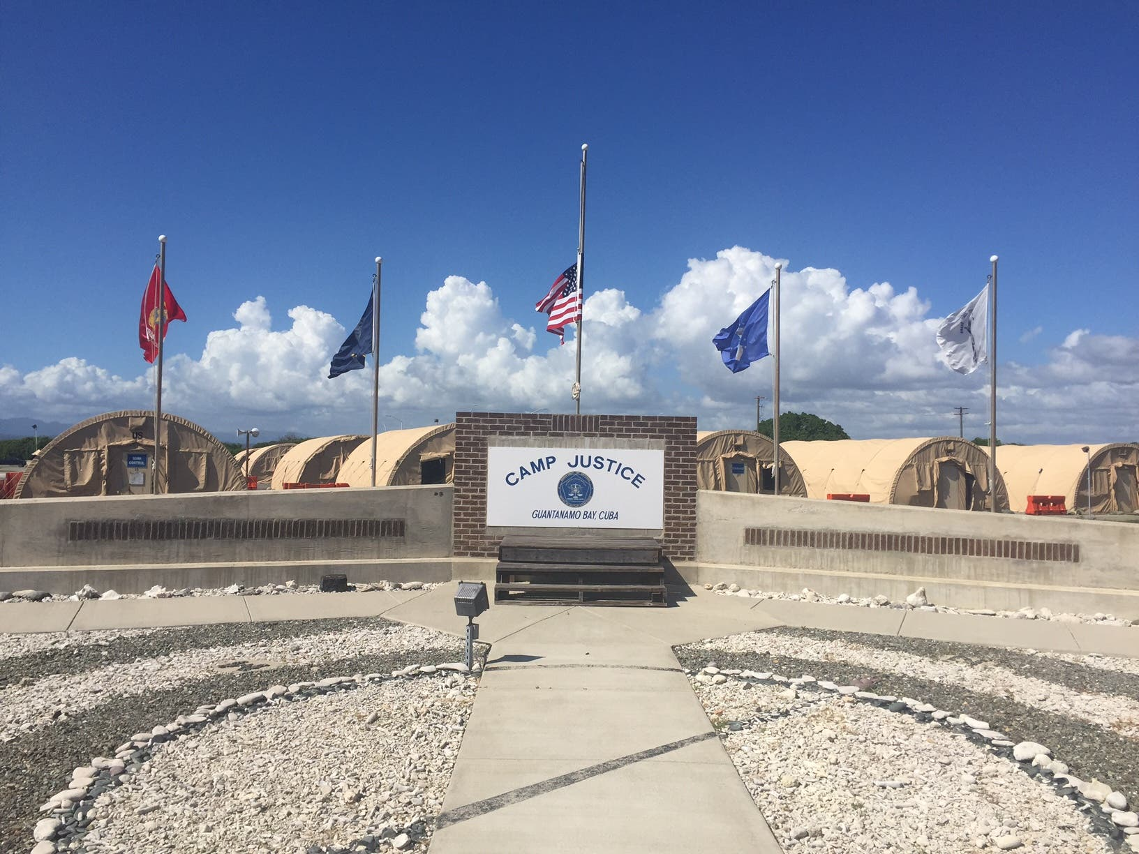 The US flag is seen at half-staff on December 6, 2015 near the military courtroom in Guantanamo Bay, Cuba. (AFP)