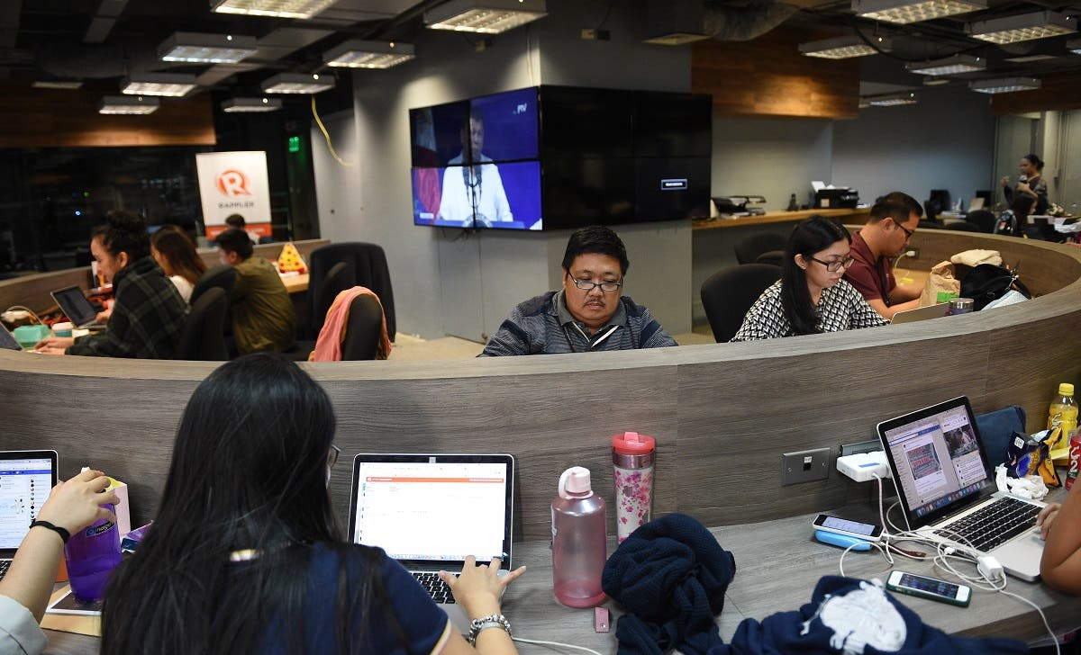 This file photo taken on January 15, 2018 shows employees of online portal Rappler working at the company's editorial office in Manila. (AFP)