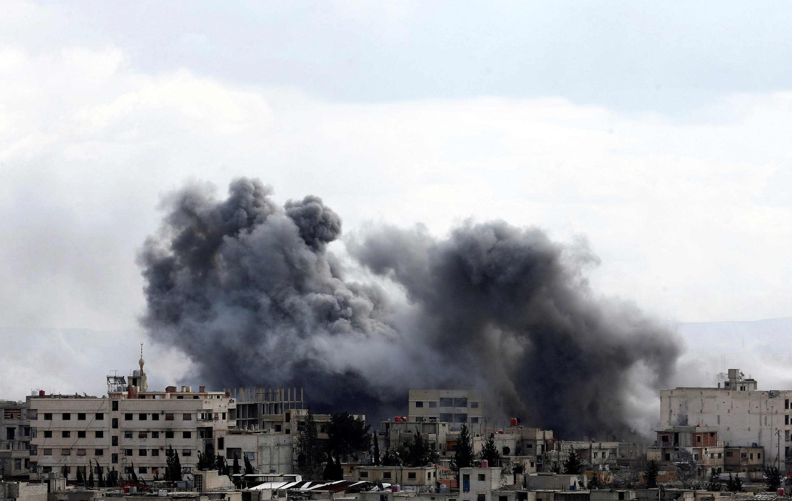 Smoke rises from the besieged Eastern Ghouta in Damascus. (Reuters)