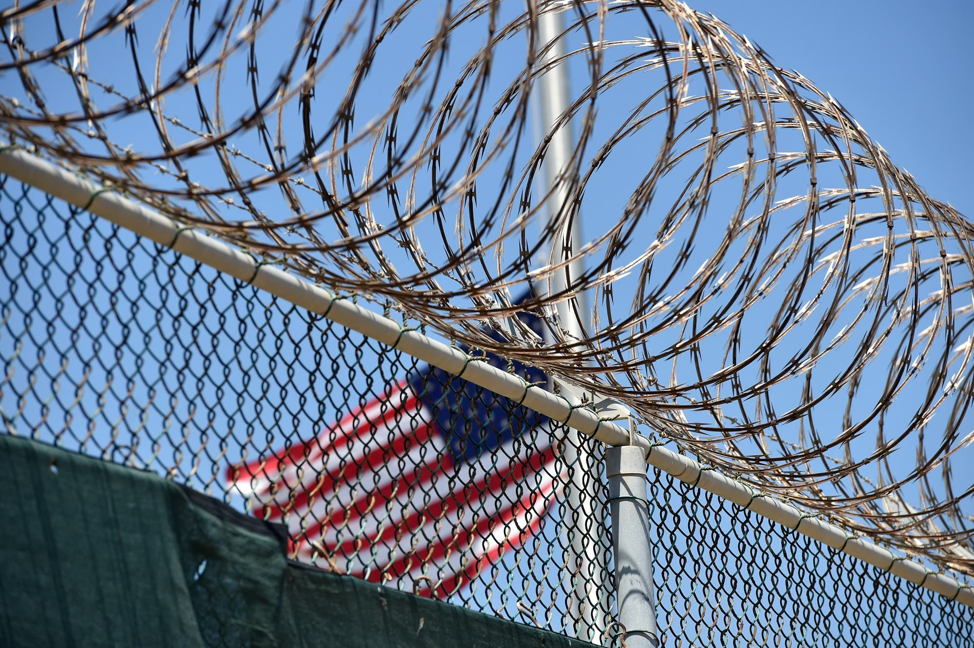 "Wire-topped fence of ""Camp 6"" detention facility at the US Naval Station in Guantanamo Bay, Cuba, on April 8, 2014. (AFP)"