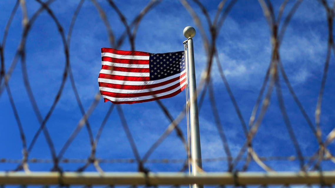 US flag flies over Camp VI at the US Naval Base at Guantanamo Bay, March 5, 2013. (Reuters)