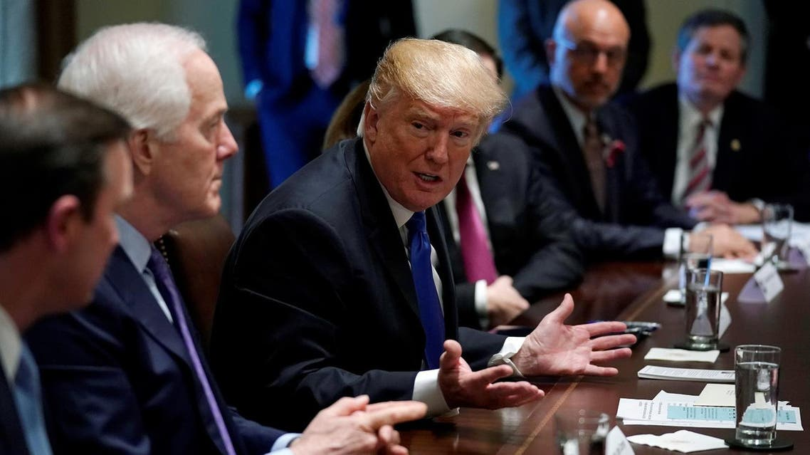 US President Donald Trump meets with bi-partisan members of Congress to discuss school and community safety in the wake of the Florida school shootings at the White House on February 28, 2018. (Reuters)