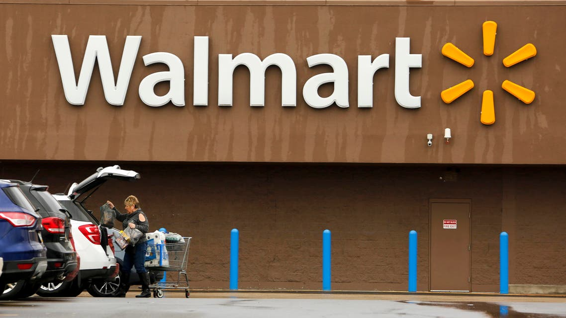 A shopper loads her car after shopping at a Walmart in Pittsburgh. (AP)