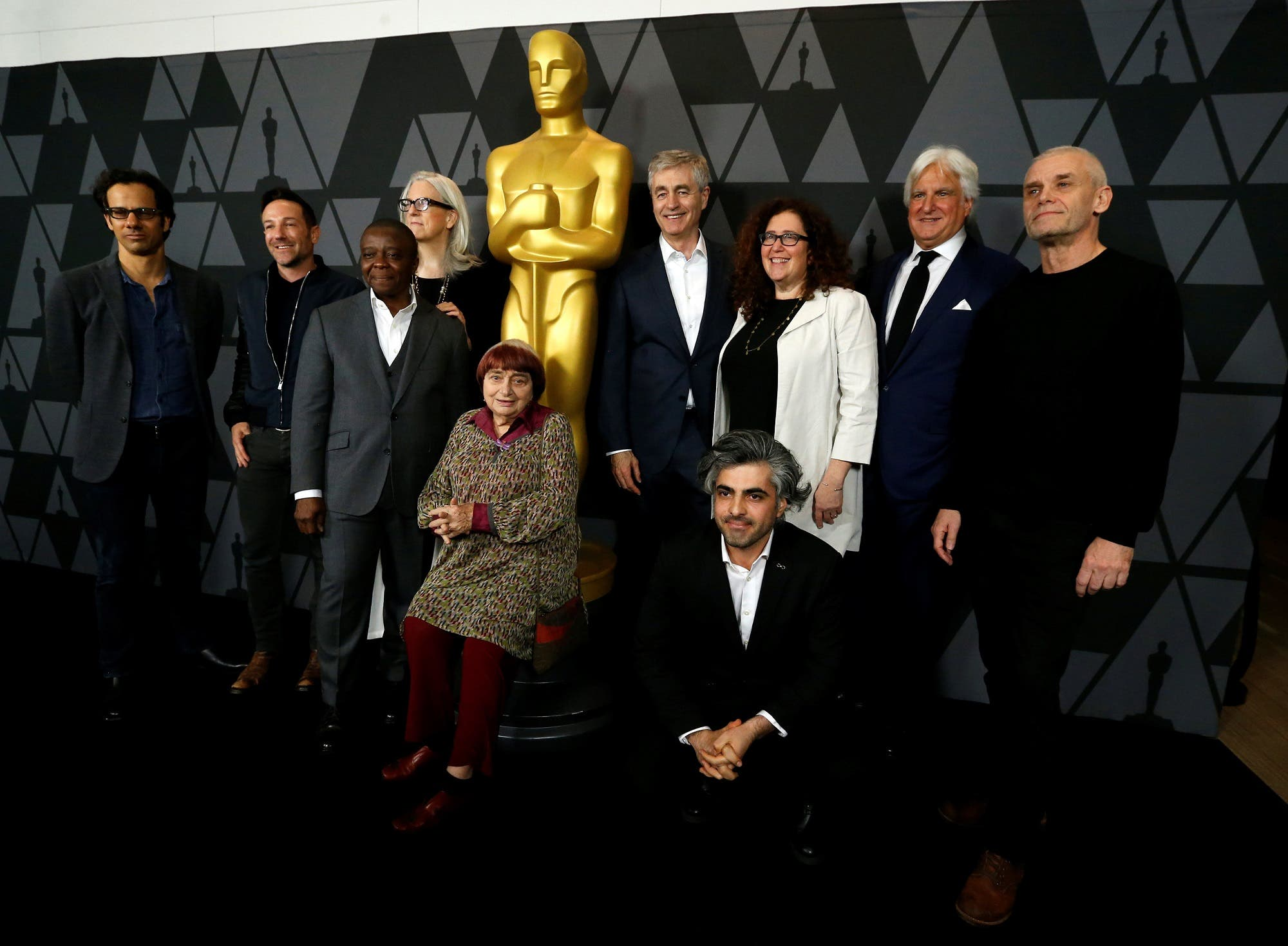 Documentary Feature nominees pose for a group photo at the reception for the 2017 Oscar-nominated films in Beverly Hills on February 28, 2018. (Reuters)