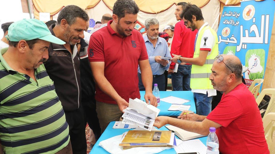 Syrian refugees register at Zaatari refugee camp near Amman on October 4, 2017. (AFP)
