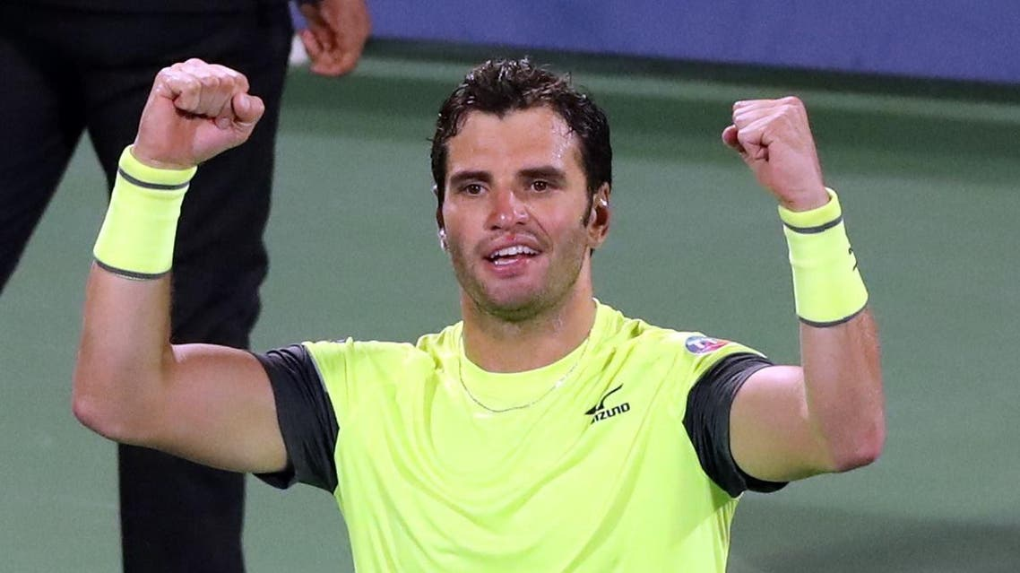 Malek Jaziri of Tunisia celebrates after defeating Stefanos Tsitsipas of Greece (unseen) in the 2018 ATP Dubai Duty Free Tennis Championships on March 1, 2018. Jaziri won 6-4, 3-6 and 6-3 to reach the Semi-final. (AFP)