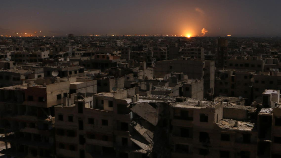 Flames following a reported rocket attack is seen on the horizon in the rebel-held enclave of Eastern Ghouta on February 28, 2018.  Mohammed EYAD / AFP