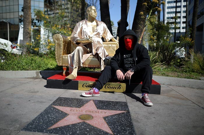 Artist Plastic Jesus sits on his statue of Harvey Weinstein on a casting couch on Hollywood Boulevard near the Dolby Theatre during preparations for the Oscars in Hollywood, Los Angeles, California, US March 1, 2018. (Reuters)