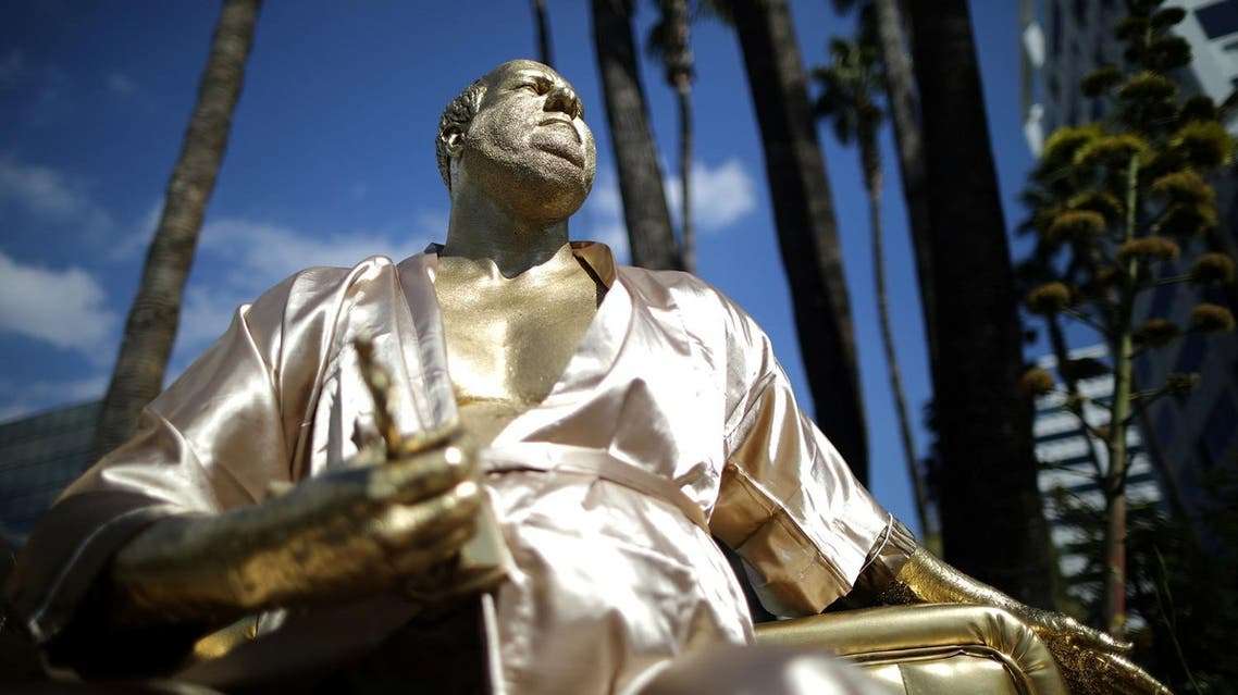 A statue of Harvey Weinstein on a casting couch made by artist Plastic Jesus is seen on Hollywood Boulevard near the Dolby Theatre during preparations for the Oscars in Hollywood, Los Angeles, California, US March 1, 2018. (Reuters)
