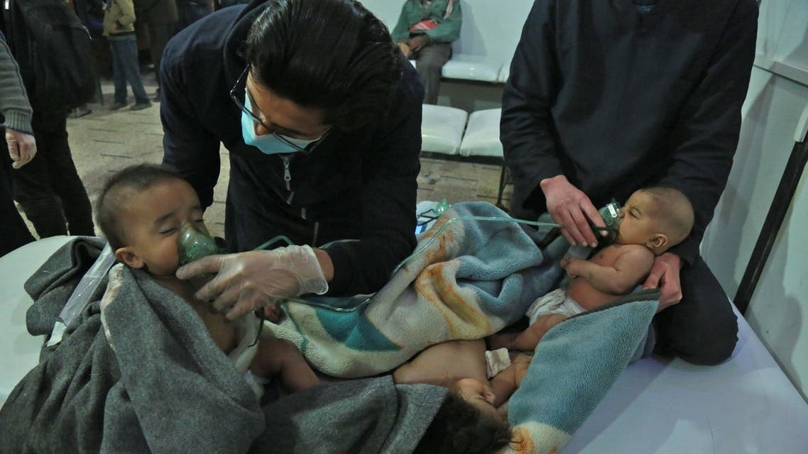 Syrian babies receive treatment for a suspected chemical attack at a makeshift clinic on the rebel-held village of al-Shifuniyah in the Eastern Ghouta region on the outskirts of the capital Damascus late on February 25, 2018. A child died and at least 13 other people suffered breathing difficulties after a suspected chemical attack on the besieged Syrian rebel enclave, a medic and a monitor said. The Britain-based Syrian Observatory for Human Rights said 14 civilians had suffered breathing difficulties after a regime warplane struck the village.   HAMZA AL-AJWEH / AFP
