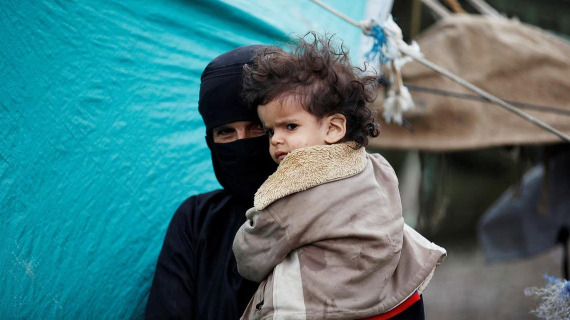 A woman holds her grandson at a camp for internally displaced people near Sanaa, Yemen, August 10, 2016. (Reuters)