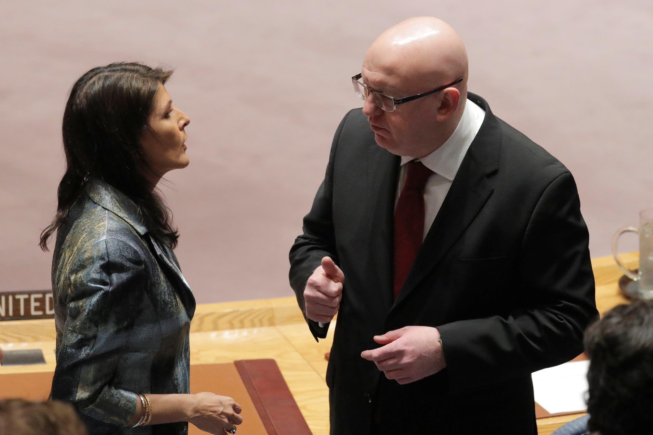 U.S. United Nations ambassador Nikki Haley speaks with Russian ambassador to the UN Vasily Nebenzya before a meeting of the UN Security Council at UN headquarters in New York, U.S., February 20, 2018. REUTERS/Lucas Jackson