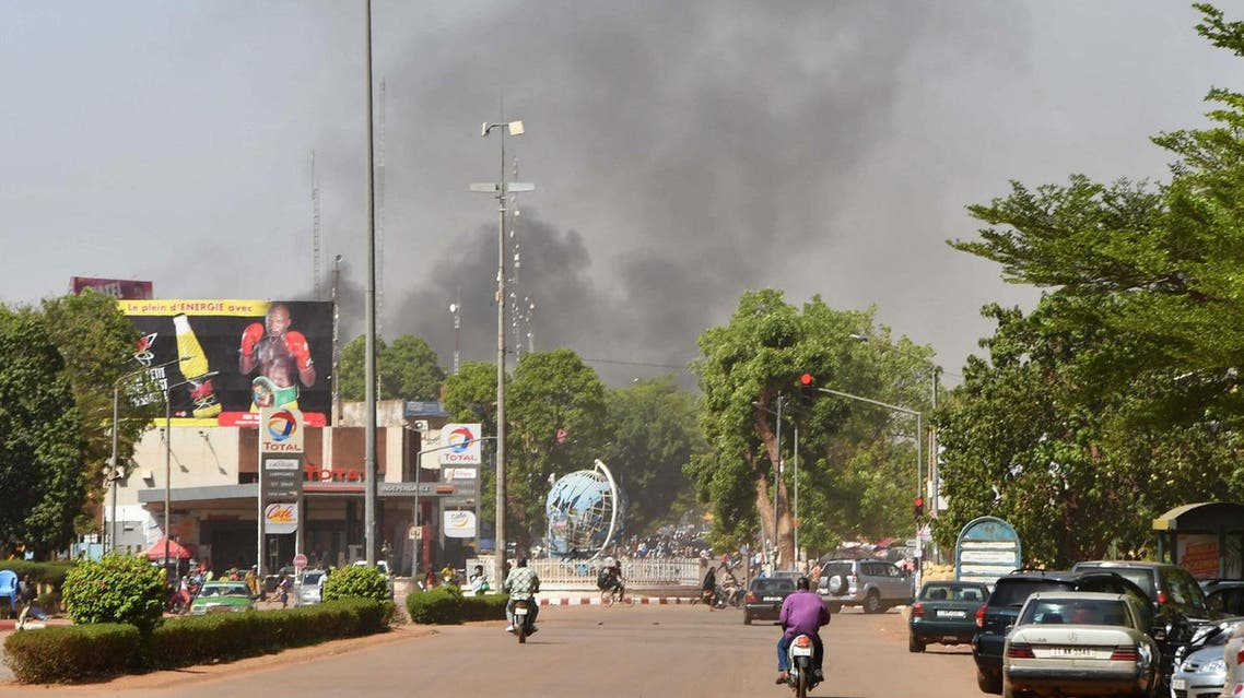 Smoke rises from the site of an armed attack in downtown Ouagadougou, Burkina Faso, on March 2, 2018. (Reuters)
