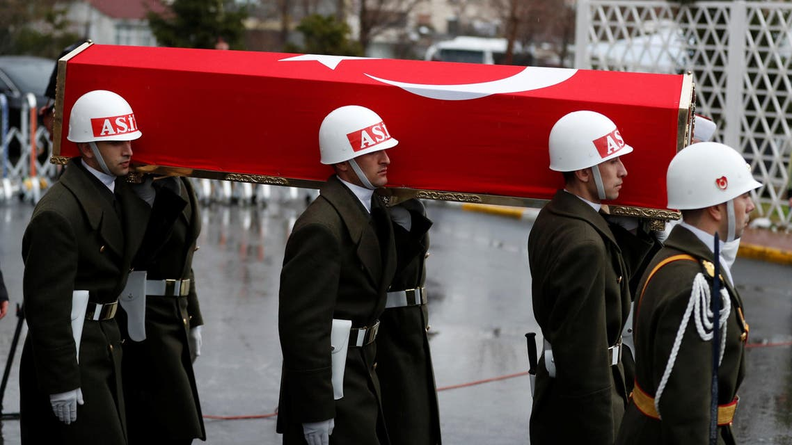 The flag-wrapped coffin with the body of Koray Karaca, a Turkish soldier who was killed during the operation against Syria's Afrin region, is carried by guard of honour members during his funeral ceremony in Istanbul, Turkey February 11, 2018. REUTERS/Osman Orsal